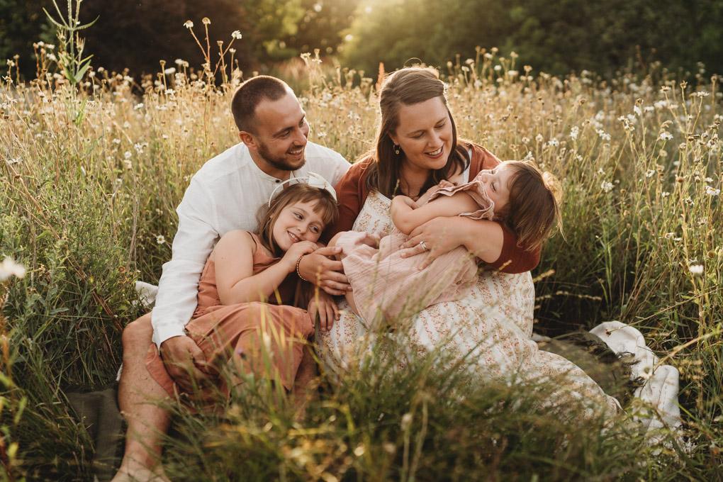 happy family in the daisy field near southampton