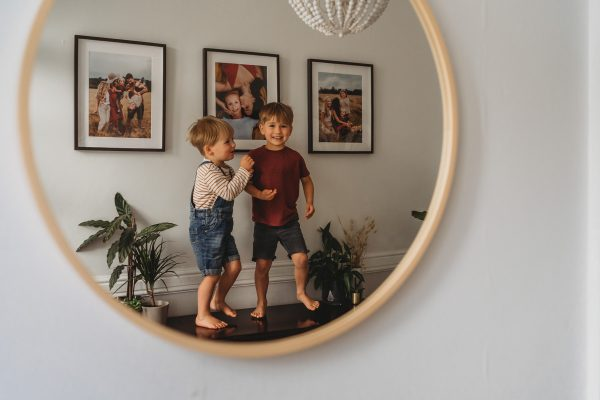 Children dancing on sideboard at home